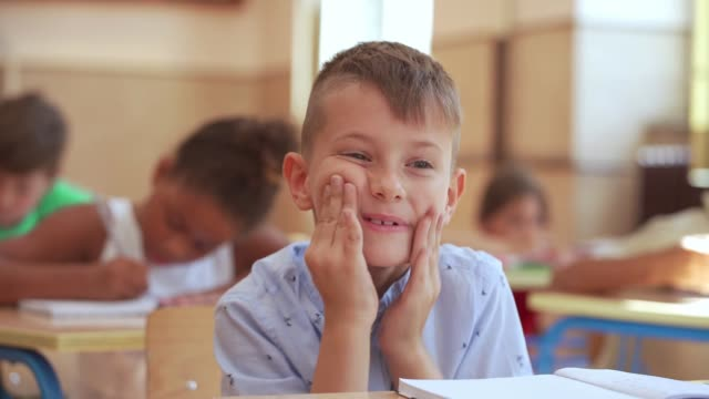 portrait of an elementary school student in a classroom making faces - toothy smile stock videos & royalty-free footage
