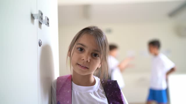portrait of an elementary student in the corridor at school - school uniform stock videos & royalty-free footage