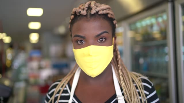 portrait of an employee using digital tablet in a bakery or supermarket with face mask - looking at camera stock videos & royalty-free footage
