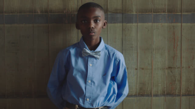 portrait of an intense african-american boy leaning against a wall - formal stock videos & royalty-free footage