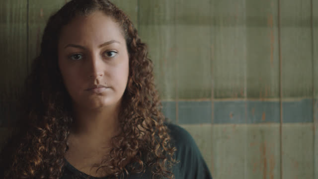 portrait of an strong young hispanic woman glaring into the camera - sadness stock videos & royalty-free footage