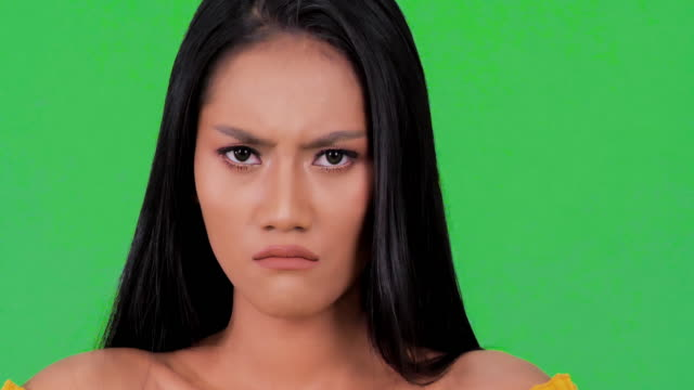 Portrait of angry young black woman.Beauty black woman with a long straight hair.Expressive facial expressions.Cosmetology and Spa.Beauty Face.Emotion concept.Green Screen