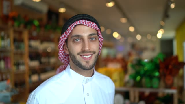portrait of arab middle east man at his small business - middle eastern culture stock videos & royalty-free footage