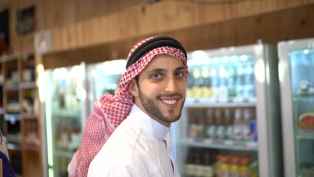 portrait of arab middle east man buying at refrigerated section - middle eastern ethnicity stock videos & royalty-free footage