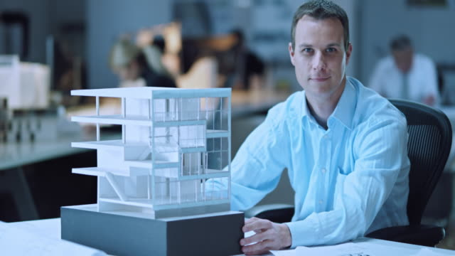 DS Portrait of architect checking the architectural model