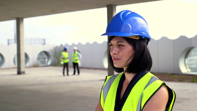 portrait of architect woman - one mid adult woman only stock videos & royalty-free footage