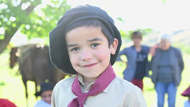 portrait of argentine gaucho boy in traditional clothing - argentinian culture stock videos & royalty-free footage