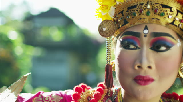 portrait of artistic legong balinese female dancer indonesia - religious dress stock videos & royalty-free footage