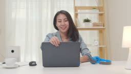 Portrait of Asia freelance smart business women casual wear using laptop working in living room at home.