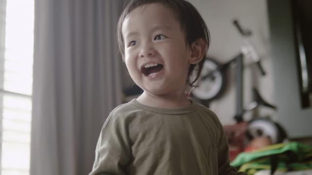 Portrait Of Asian Baby Boy Dancing