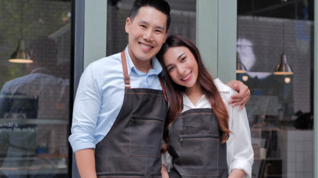 portrait of asian couples small business owner with smiling.business,entrepreneur,small business,success concept - males stock videos & royalty-free footage