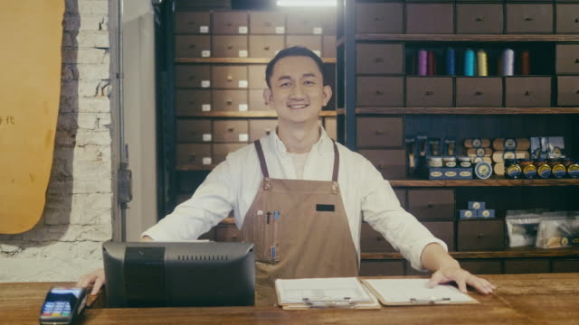 portrait of asian customer service employee at the mens boutique (slow motion) - taipei stock videos & royalty-free footage
