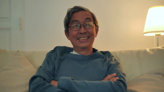 portrait of asian elderly men smiling at the camera,stay at home to prevent epidemics of coronavirus or covid-19. retirement,people,lifestyle, medical,heathcare and medicine,lifestyle,south east and east asia: people aged 50+,coronavirus or covid-19 - recovery stock videos & royalty-free footage
