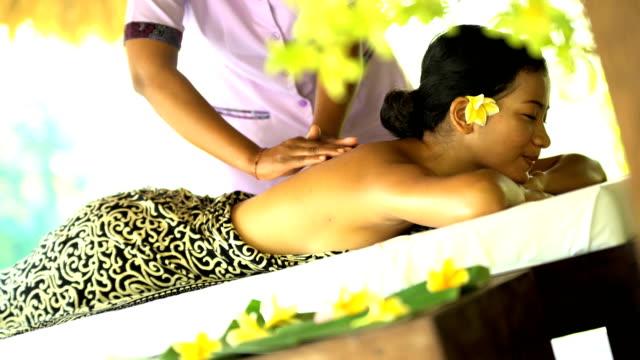portrait of asian female enjoying balinese aromatherapy massage - balinese culture stock videos & royalty-free footage