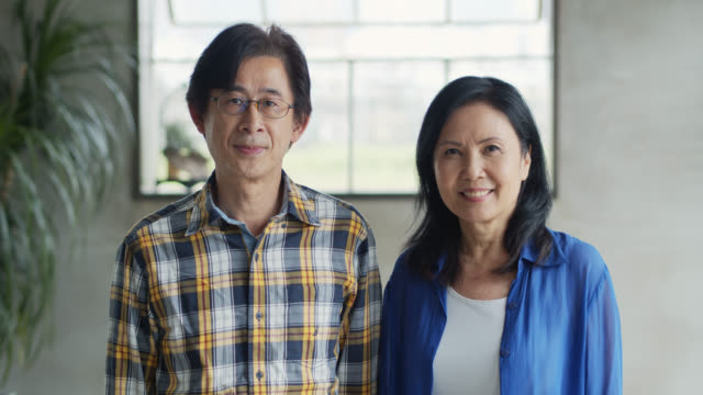 portrait of asian man and woman in their 50s - mature couple stock videos & royalty-free footage