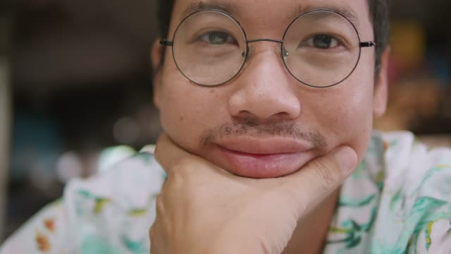 portrait of asian man looking at camera , smile , happy. - focus on foreground stock videos & royalty-free footage