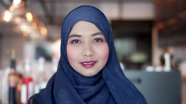 portrait of asian muslim woman look at camera and smile. - middle east stock videos & royalty-free footage