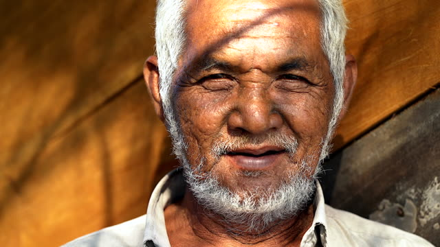 portrait of asian old man looking at the camera. - indigenous culture stock videos & royalty-free footage