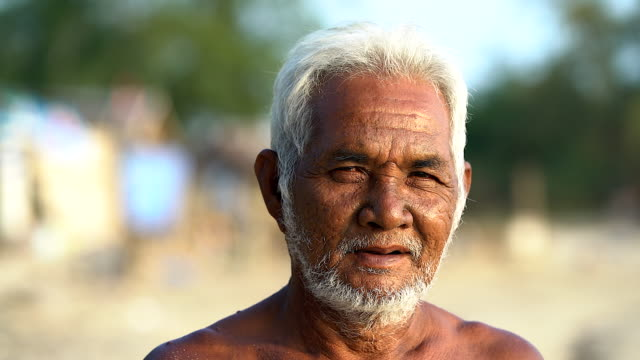 portrait of asian old man looking at the camera. - sad old asian man stock videos & royalty-free footage