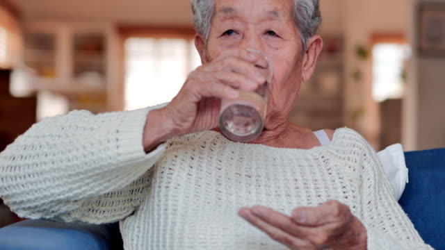 portrait of asian older woman have a feel sick and taking pills for her health or taking vitamins at home.medical, care, retirement, lifestyle, healthcare and medicine, elderly people healthcare, life insurance, science, pharmacy concept, feeling sick. - moving activity stock videos & royalty-free footage