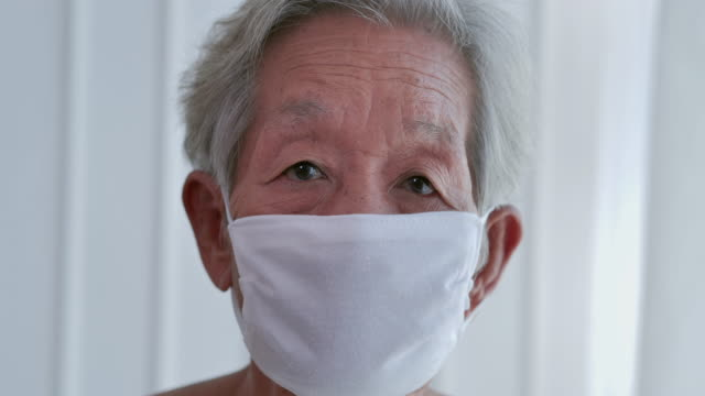 portrait of asian senior women wearing mask protecting from crisis coronavirus covid-19 of smiling and looking at camera in mask.portrait,senior healthcare,medical,smiling,positive emotion,protective face mask,conquering adversity,resilience,cheerful - 70 79 years stock videos & royalty-free footage