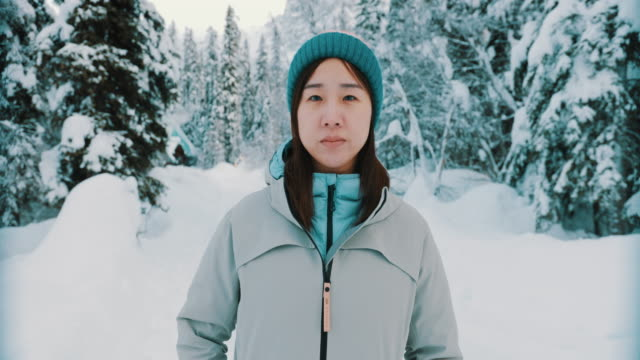portrait  of asian woman in winter forest - chinaface stock videos & royalty-free footage