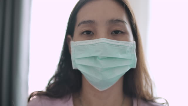portrait of asian woman with face mask - femininity stock videos & royalty-free footage