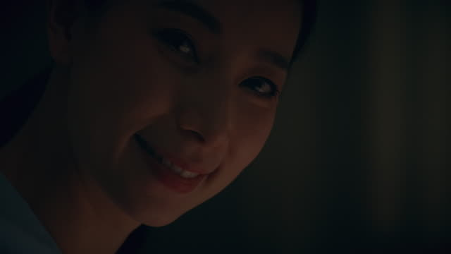 portrait of asian woman working late at night and looking at camera. - columnist stock videos & royalty-free footage