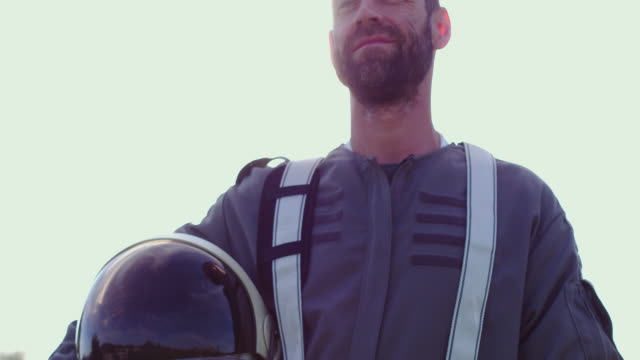 portrait of astronaut holding helmet - space helmet stock videos & royalty-free footage