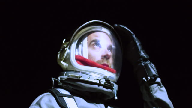 portrait of astronaut in space suit - work helmet stock videos & royalty-free footage
