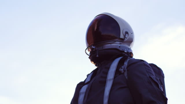 portrait of astronaut in space suit - fade out video transition stock videos & royalty-free footage
