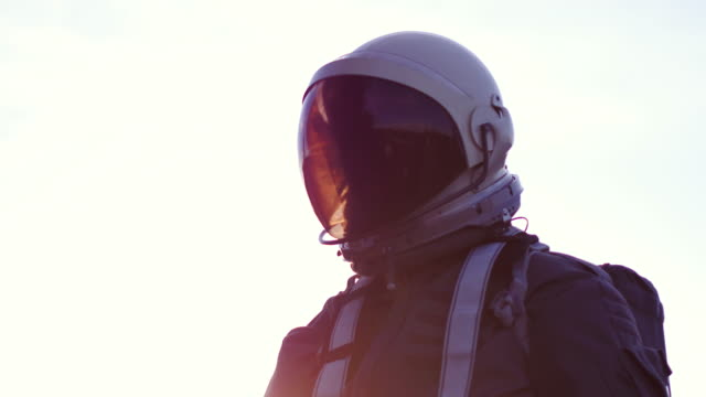 portrait of astronaut in space suit - weltraum mission stock-videos und b-roll-filmmaterial