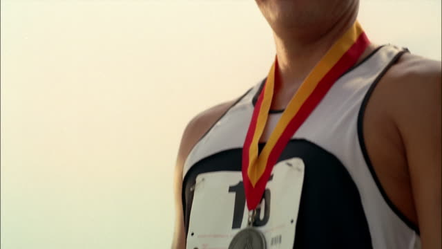 portrait of athlete wearing gold medal / holding medal up for camera and making number 1 sign / georgia - gold medalist stock videos & royalty-free footage