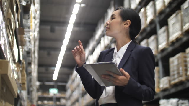 portrait of attracive business black women entrepreneur in corporate suit standing in warehouse, women in stem, innovation,leadership concept - examining stock videos & royalty-free footage