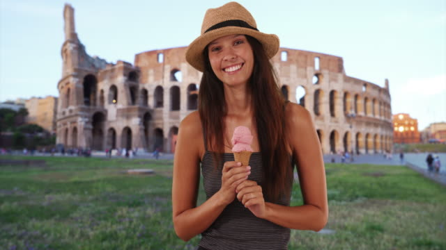 portrait of attractive tourist woman in rome holding ice cream cone - gelato stock videos & royalty-free footage