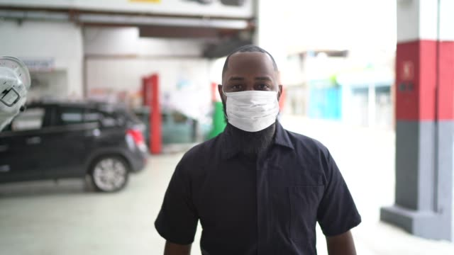 portrait of auto mechanic man at auto repair shop - career stock videos & royalty-free footage