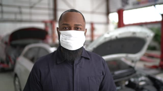 portrait of auto mechanic man at auto repair shop - mechanic stock videos & royalty-free footage