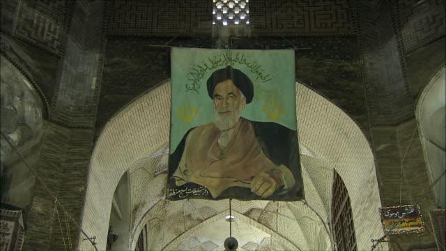 zi ms portrait of ayatollah khomeini hanging under ceiling of grand bazaar, isfahan, iran - iran stock videos & royalty-free footage