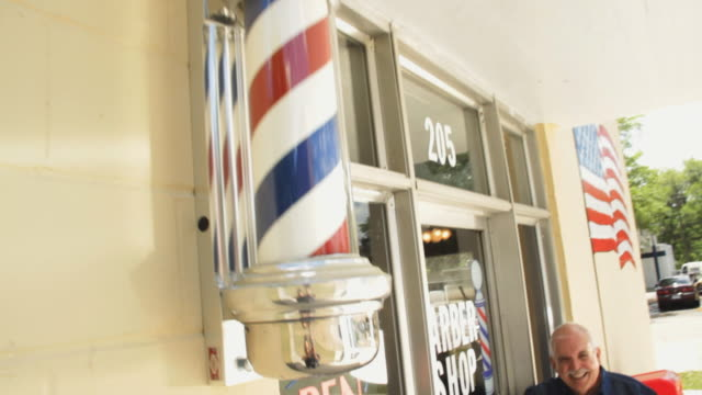 ms td portrait of barber in front of barber shop / madison, florida, usa - stange stock-videos und b-roll-filmmaterial