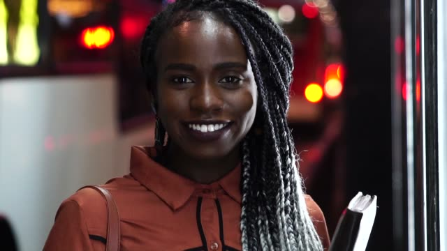 portrait of beautiful afro woman with city lights on background - pardo brazilian stock videos & royalty-free footage