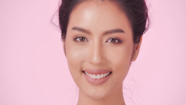 portrait of beautiful and sexy woman on pink background.beautiful woman smiling.expressive facial expressions.cosmetology and spa.beauty face.video: diverse portraits - model object stock videos & royalty-free footage