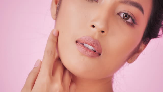 portrait of beautiful and sexy woman on pink background.beautiful woman touching her face.expressive facial expressions.cosmetology and spa.beauty face.video: diverse portraits - video portrait stock videos & royalty-free footage