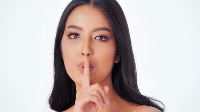 portrait of beautiful and sexy woman on white background.sexy woman with finger on her red lips showing shush.expressive facial expressions.cosmetology and spa.beauty face.video: diverse portraits - beautiful woman stock videos & royalty-free footage