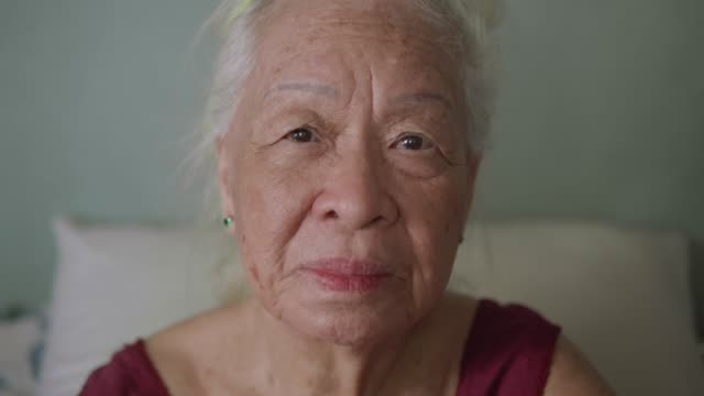 portrait of beautiful asian senior woman, positive emotion. - focus on foreground stock videos & royalty-free footage