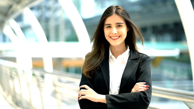 Portrait Of Beautiful Business Woman Wear Black Suit Look Smile On Her Face And Looking At The Camera On Modern Office Background