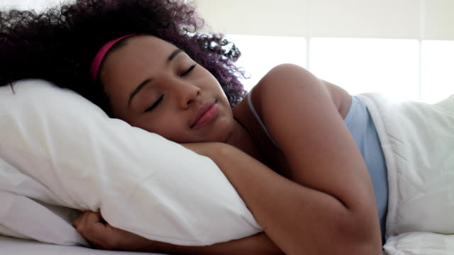 Portrait Of Beautiful Happy Black Girl Waking Up Slow Motion