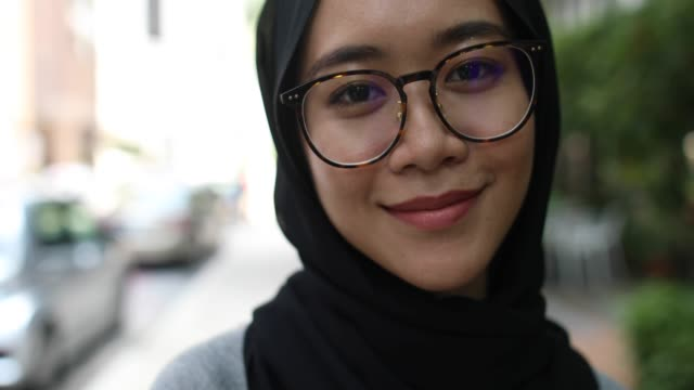 portrait of beautiful malaysian girl - hijab stock videos & royalty-free footage
