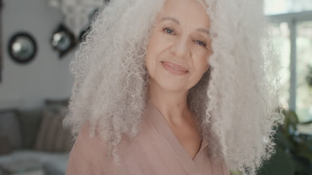 portrait of beautiful senior adult woman at home - 60 64 years stock videos & royalty-free footage