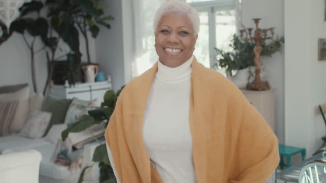 portrait of beautiful senior adult woman at home - the ageing process stock videos & royalty-free footage