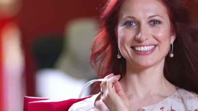 hd slow motion: portrait of beautiful shopaholic - shopaholic stock videos & royalty-free footage